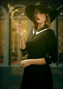 Ysbrand Cosijn RETRO WOMAN IN HAT SMOKING OUTSIDE BUILDING Women