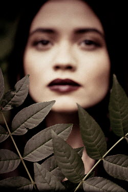 Esme Mai SERIOUS WOMAN WITH LEAVES OUTDOORS Women