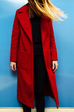 Esme Mai BLONDE WOMAN IN RED COAT INDOORS Women
