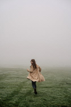 Esme Mai WOMAN RUNNING IN FOGGY FIELD Women