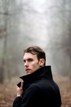 Esme Mai SERIOUS MAN WITH COAT IN FOGGY COUNTRYSIDE Men