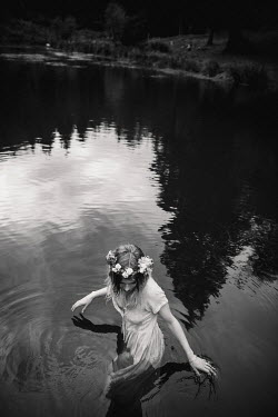 Esme Mai GIRL WITH WHITE DRESS AND FLOWERS IN RIVER Women