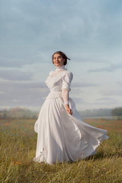Joanna Czogala WOMAN WITH WHITE DRESS IN SUMMERY COUNTRYSIDE Women
