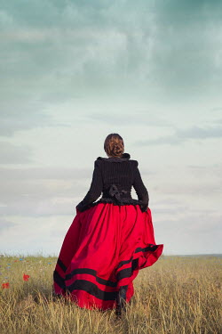 Joanna Czogala BRUNETTE HISTORICAL WOMAN WALKING IN FIELD Women