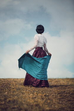Magdalena Russocka historical woman with shawl standing in field
