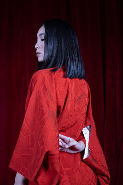 Marta Syrko SERIOUS ASIAN WOMAN IN RED SILK JACKET Women