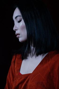 Marta Syrko SERIOUS ASIAN WOMAN IN RED SILK JACKET Women