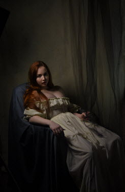 Daniel Murtagh SERIOUS GIRL WITH RED HAIR SITTING IN CHAIR Women