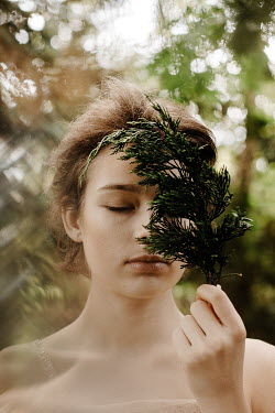 Esme Mai GIRL WITH CLOSED EYES HOLDING LEAVES OUTDOORS Women