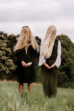 Esme Mai TWO WOMEN IN COUNTRYSIDE WITH HAIR COVERING FACES Women
