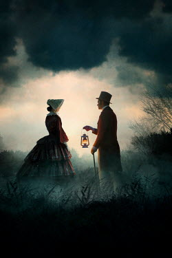 Lee Avison VICTORIAN COUPLE WITH LANTERN IN COUNTRYSIDE AT DUSK Couples