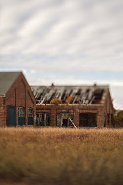 Lisa Bonowicz DERELICT RED BRICK WAREHOUSES IN FIELD Miscellaneous Buildings