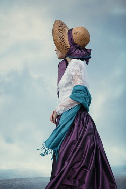 Magdalena Russocka close up of historical woman wearing bonnet standing in field