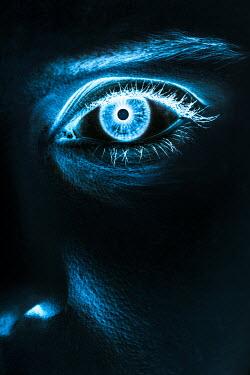 Magdalena Russocka close up of eerie female eye in shadow
