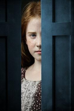 Magdalena Russocka teenage girl peeking through ajar door