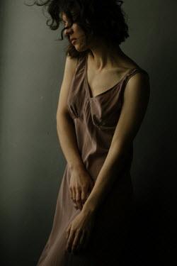 Marta Syrko SERIOUS WOMAN WITH DARK HAIR IN SHADOW Women