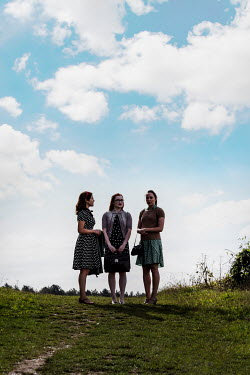 Stephen Mulcahey THREE WOMEN STANDING IN SUMMERY COUNTRYSIDE Groups/Crowds