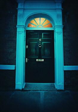 Lyn Randle DOORWAY OF HISTORICAL HOUSE AT NIGHT Building Detail