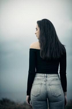 Mohamad Itani TEENAGE GIRL WITH LONG DARK HAIR OUTDOORS Women
