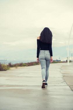 Mohamad Itani GIRL WITH LONG DARK HAIR WALKING BY SEA Women