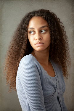 Miguel Sobreira SERIOUS GIRL WITH LONG CURLY HAIR Women