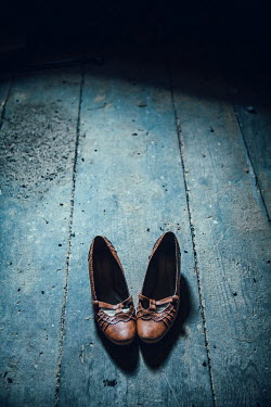 Magdalena Russocka women's shoes abandoned on old wooden floor