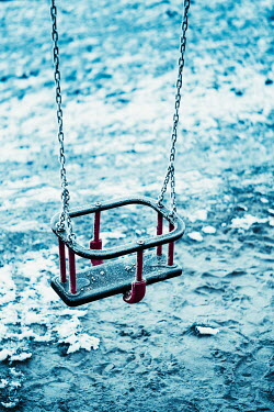 Magdalena Russocka empty swing on playground in winter