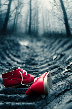 Magdalena Russocka red child's shoes abandoned on muddy road