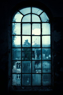 Magdalena Russocka old window in derelict industrial building with cityscape