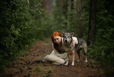Alexandra Bochkareva WOMAN WITH ORANGE HAIR AND DOG IN FOREST Women