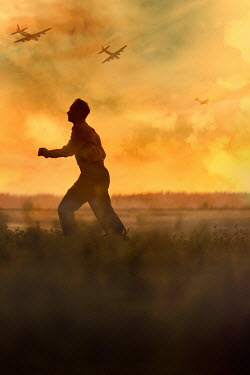 Magdalena Russocka teenage boy running in field with war planes at sunset