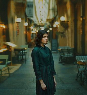 Svitozar Bilorusov BRUNETTE GIRL STANDING OUTSIDE CAFE Women