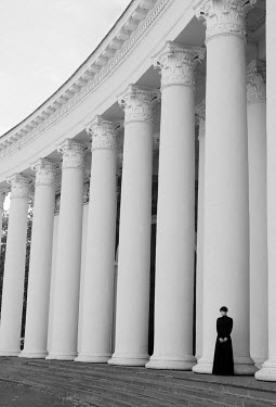 Svitozar Bilorusov WOMAN STANDING BY LARGE PILLARS Women