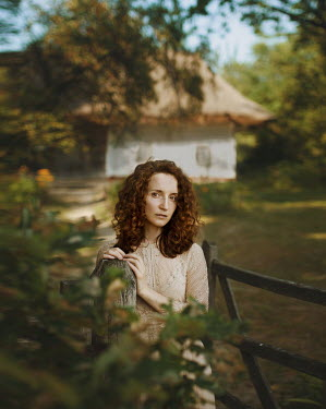Svitozar Bilorusov WOMAN STANDING OUTSIDE COTTAGE IN SUMMER Women