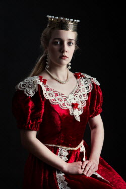Magdalena Russocka historical woman in red gown wearing crown inside