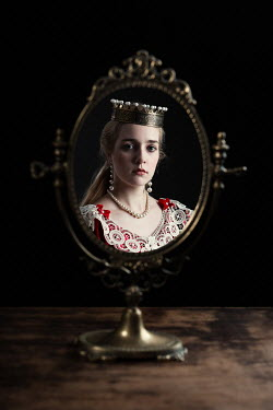 Magdalena Russocka historical woman in red gown wearing crown reflected in table mirror