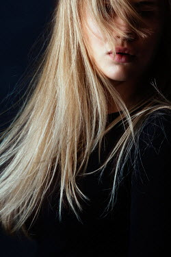 Magdalena Russocka close up of blonde woman with blown hair inside