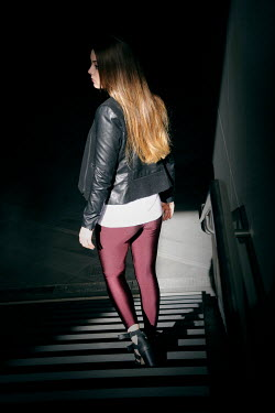 Ute Klaphake GIRL IN LEATHER JACKET ON STEPS IN SHADOW Women