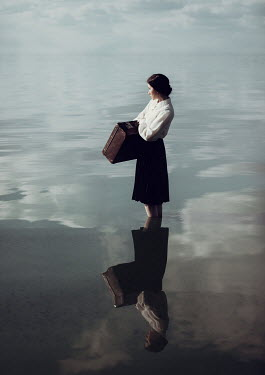 Dorota Gorecka WOMAN CARRYING SUITCASE STANDING IN SEA Women