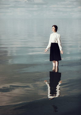 Dorota Gorecka SERIOUS GIRL STANDING IN SERENE SEA