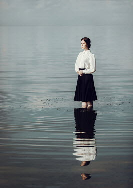 Dorota Gorecka SERIOUS GIRL STANDING IN RIPPLED SEA Women