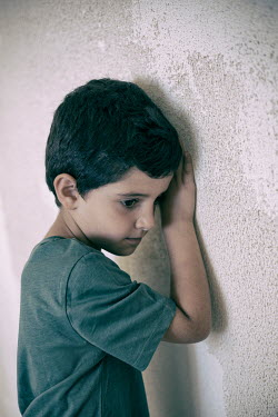 Mohamad Itani SAD LITTLE BOY LEANING ON WALL Children