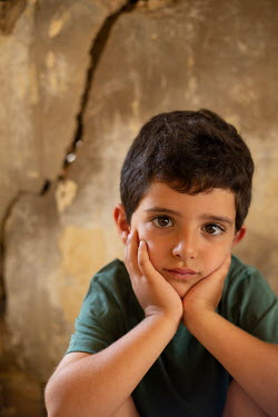 Mohamad Itani BOY WITH HEAD LEANING ON HANDS BY WALL Children