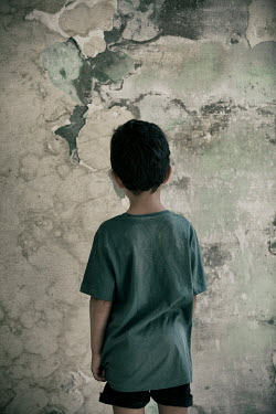 Mohamad Itani LITTLE BOY STARING AT PEELING WALL Children