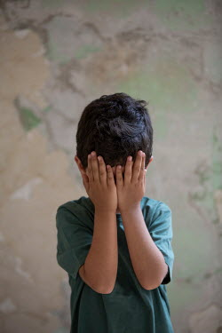 Mohamad Itani LITTLE BOY HIDING FACE IN HANDS BY WALL Children