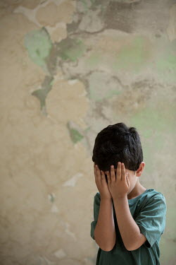 Mohamad Itani LITTLE BOY HIDING FACE IN HANDS BY WALL Women