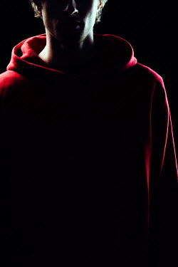 Magdalena Russocka modern man wearing red hoodie in shadow  insiade