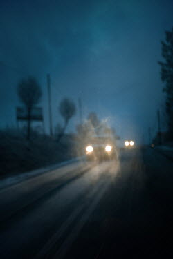 Magdalena Russocka two cars with headlights on misty country road