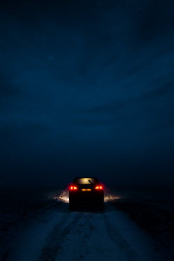 Magdalena Russocka car on snowy country road at night
