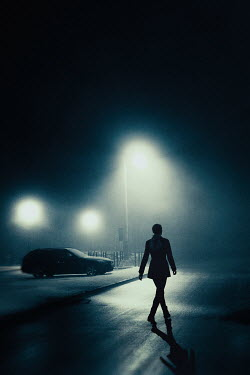 Magdalena Russocka modern woman walking on snowy car park at night